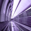 Abstract violet station with moving train — Stock Photo