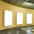 Empty frames on yellow wall — Stock Photo