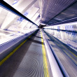 Moving escalator in airport - Stock Photo