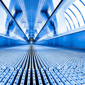 Blue modern escalator in business center — Stock Photo