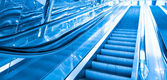 Blue moving escalator — Stock Photo