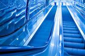 Blue modern escalator in business center — Stock Photo