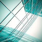 Modern green glass skyscraper perspective view — Stock Photo