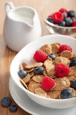 Cornflakes with fresh berries — Stock Photo