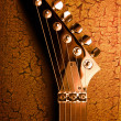 Stock Photo: Top of guitar over grunge background