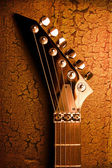 Top of guitar over grunge background — Stock Photo