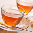 Fresh tea and cane sugar - Stock Photo