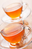 Tea and cane sugar — Stock Photo