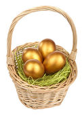 Golden easter eggs in basket isolated — Stock Photo