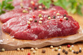 Raw beef with spices — Stock Photo