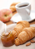 Croissant with jam for breakfast — Stock Photo