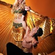 Arabic dancer with fire eater — Stockfoto