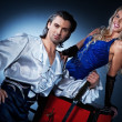 Stock Photo: Attractive couple performing sword box illusion