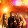 Happy friends in the night club — Stockfoto