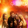 Happy friends in the night club — Stock Photo