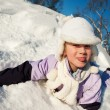 Foto Stock: Little girl sliding in snow