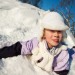 Little girl sliding in the snow — Stock Photo