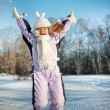 Happy girl jumping in the snow — Stock Photo #5310733