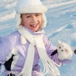 Funny little girl running in the snow — Stock Photo #5310745