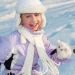 Funny little girl running in the snow — Stock Photo