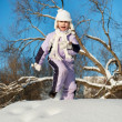 Funny little girl running in the snow — Stock Photo #5310746
