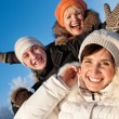 Happy friends on a winter background — Stock Photo #5310747