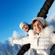 Happy smiling couple on a winter background — Stok fotoğraf