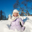 Little girl sliding in the snow — 图库照片
