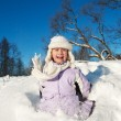 Stock Photo: Little girl sliding in the snow