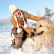 Happy woman playing with golden retriever outdoors — Stock Photo