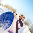 Little girl sliding in the snow — Stock Photo #5310785