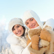 Happy friends on a winter background — Stock Photo #5310801