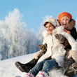 Foto Stock: Mother and daughter sliding in snow