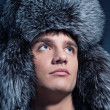 Portrait of handsome young man wearing fluffy hat — Стоковое фото #5310879