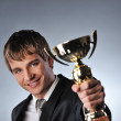 Happy businessman with a golden cup — Stock Photo #5310886