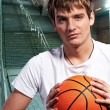 Young basketball player outdoors at night time — Stock Photo #5310903