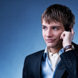 Handsome young businessman with a mobile phone — Stock Photo #5310909