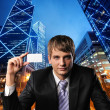 Young businessman against urban city view - Stock Photo