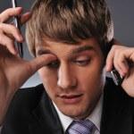 携帯電話で話している思考のビジネスマン — ストック写真 #5310929