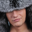Handsome young man in fur hat — Stock Photo #5310947