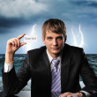 Stock Photo: Businessman over datk stormy sky