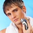 Handsome young man shaving — Photo