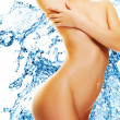 Beautiful female body over water splash background - Stock Photo