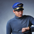 Handsome pilot looking to his watch — Stock Photo #5310996