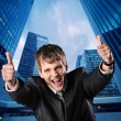 Happy businessman against his office building — Stock Photo #5311054