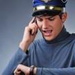 Handsome pilot talking on mobile phone — Stock Photo #5311105