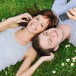 Young couple with mobile phones outdoor — Stock Photo