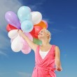 Happy girl with balloons — Stock Photo #5311172