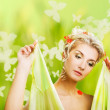 Eautiful young woman with fresh flowers in her hair. Spring concept. — Stock Photo #5311174