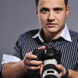 Handsome man with a photocamera — Stock Photo #5311193